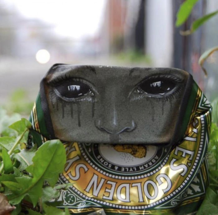 Уличное искусство на старых алюминиевых и жестяных банках