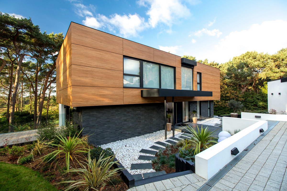 Оригинальный дом 70-х годов превратили в современный особняк