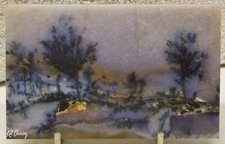 Агаты с абстрактными рисунками, напоминающими ландшафты и пейзаж