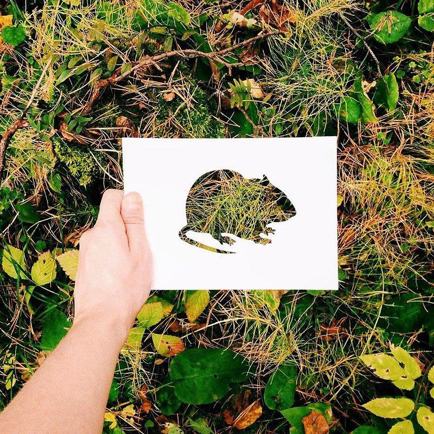 Силуэты животных из бумаги на фоне природного пейзажа
