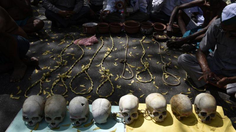 Индийские фермеры бреют голову на половину, едят крыс и хвастаются черепами самоубийц