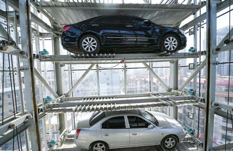 Умный 26-этажный гараж, который самостоятельно размещает автомобили