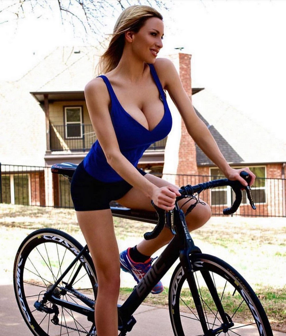 Young sexy brunette girl posing with bicycle on a background of the sea photograph by konstantin siyatskiy