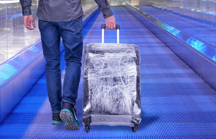 Почему нет смысла обматывать чемодан пленкой во время поездки